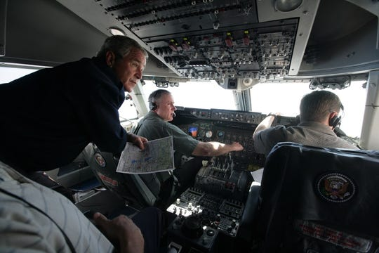 Mark Tillman, center, is at the controls of Air Force One on a flight to Al Asad Airbase in Iraq in 2007 for a visit with American troops by President George W. Bush.