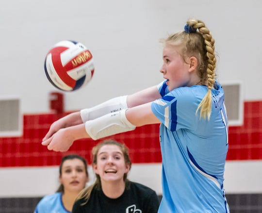Brookfield Central's McKenna Wucherer (14) bumps a serve during the match at Sussex Hamilton on Wednesday, Sept. 4, 2019.