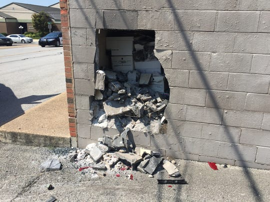 Damage is show after a vehicle crashed into The Baxter Bulletin on Thursday.