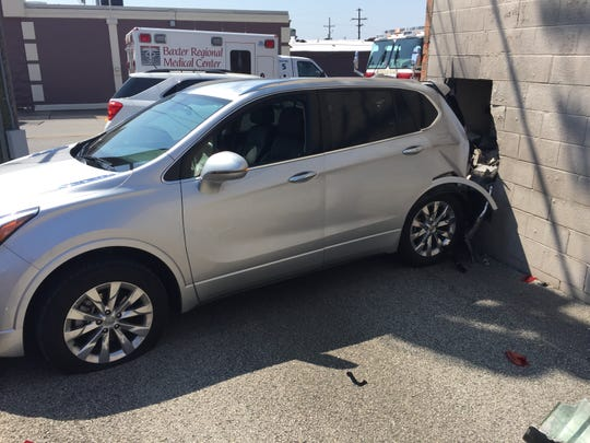 A Buick SUV crashed into The Baxter Bulletin on Thursday morning after a driver lost control while backing out of a parking spot at the Baxter County Assessor's Office.