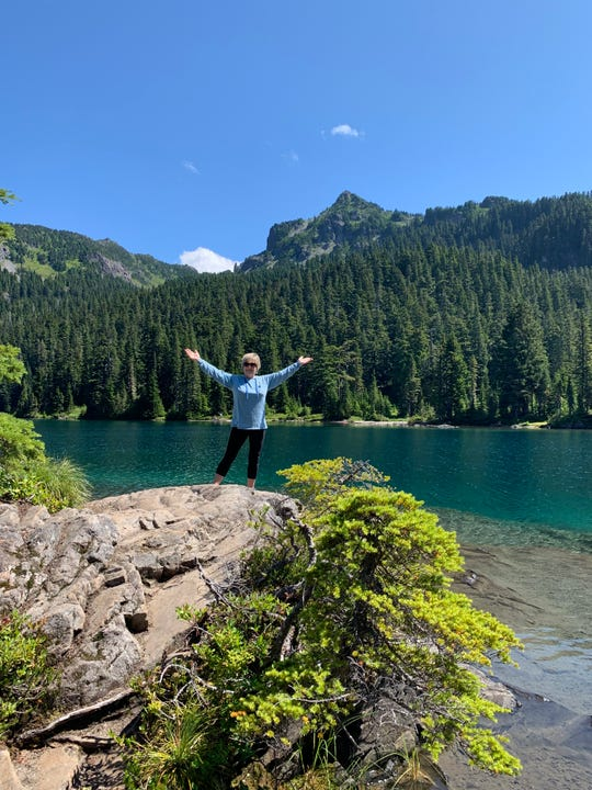 Travel Agent Dianne Newcomer is seen enjoying one of the many glacial lakes of Mount Rainier, the highest mountain peak in Washington's Cascade Range.
