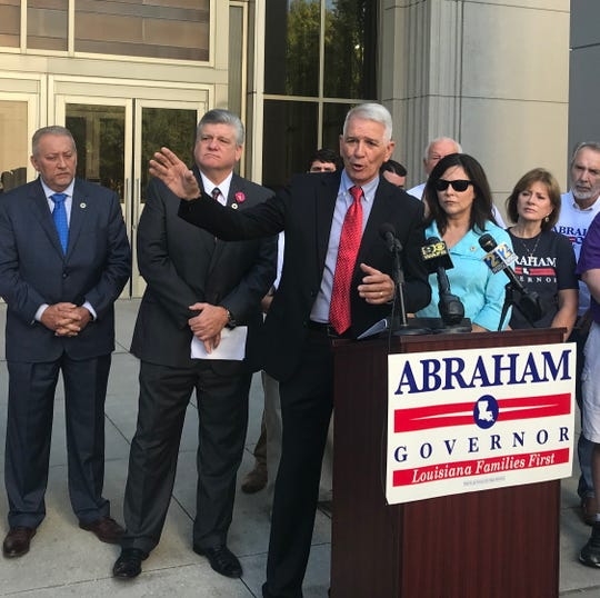 Republican Congressman Ralph Abraham, R-Alto, speaks to reporters Thursday during a press conference in which he criticized Gov. John Bel Edwards' implementation of Medicaid expansion. Abraham is running against Edwards for governor.