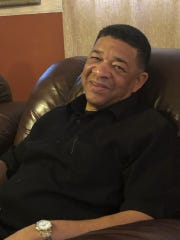 Reginald Crawford, Class of 1981 ASU alumnus, sits in the comfort of his home.