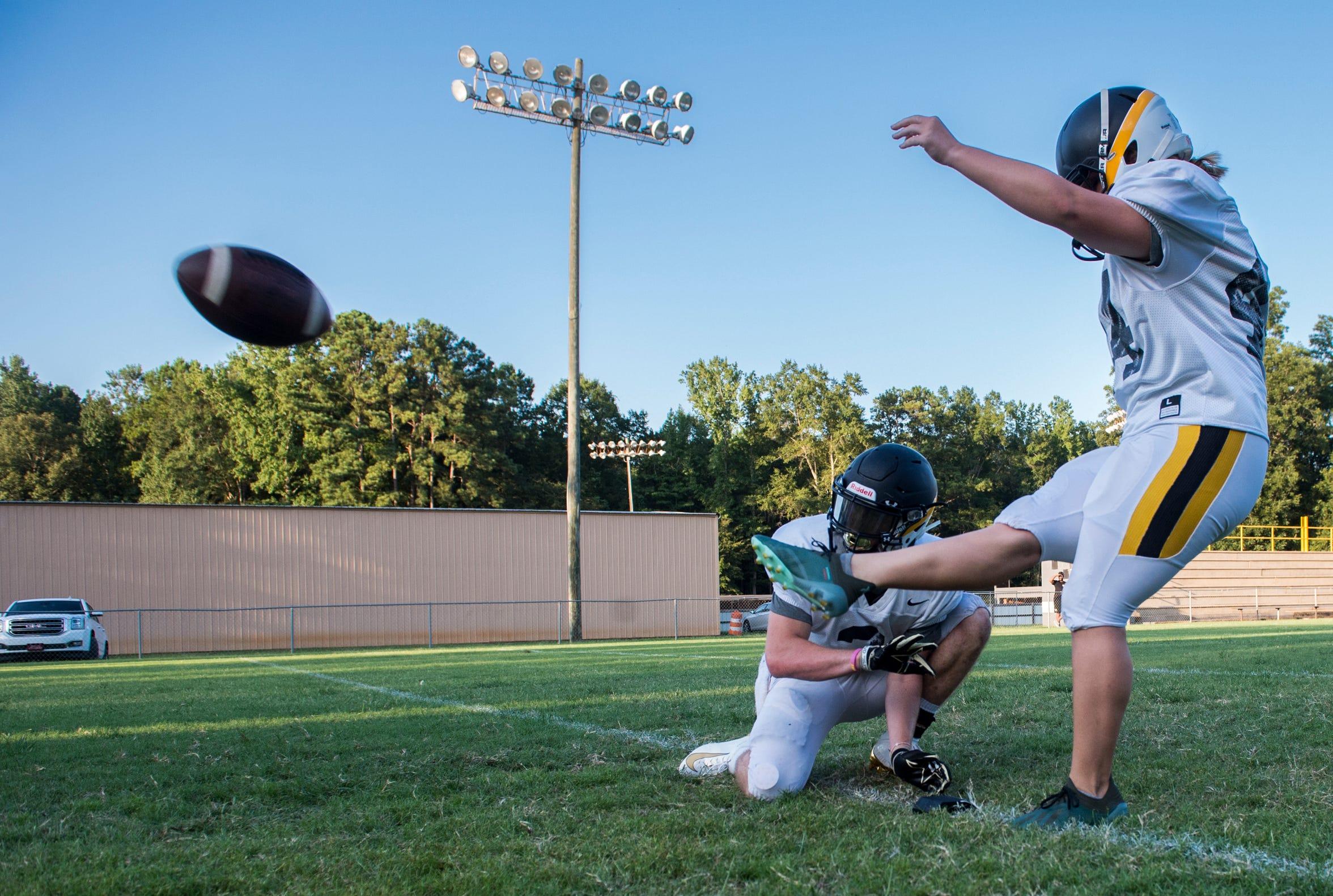 Kicker Emma Wendland kicks a field goal during football practice at Autauga Academy in Prattville, Ala., on Thursday, Aug. 15, 2019.