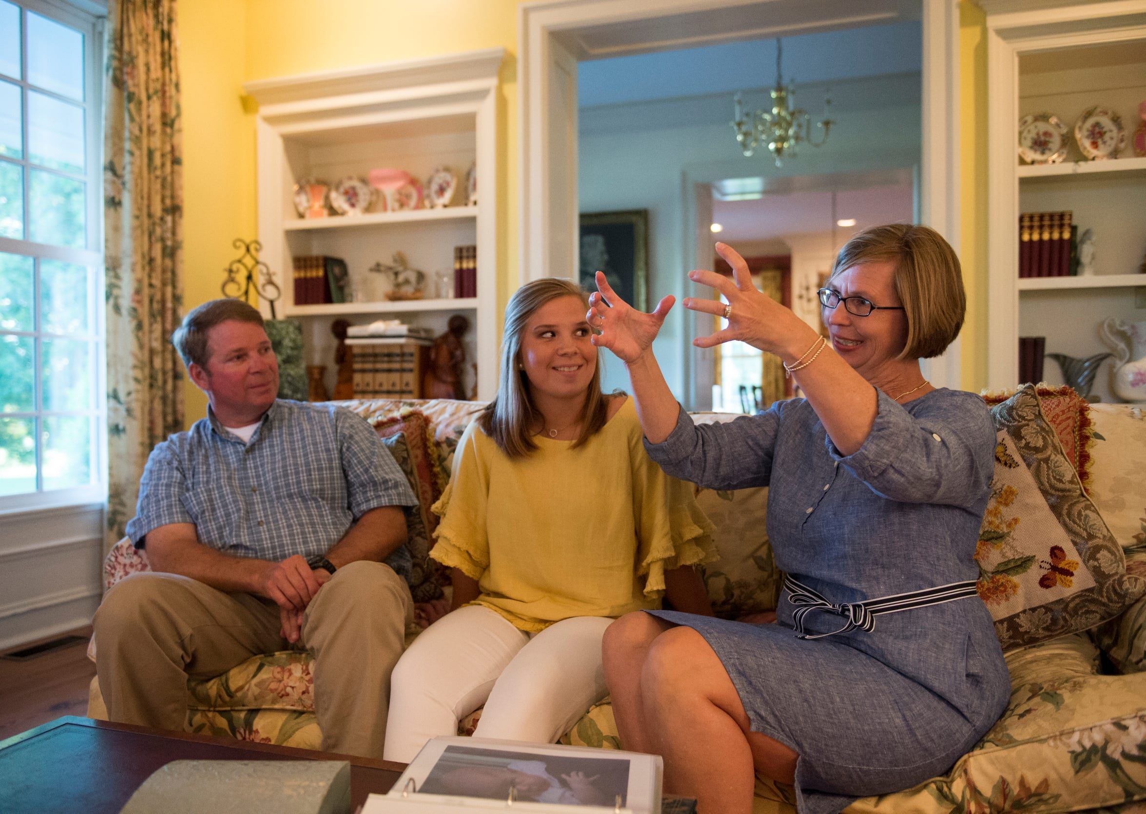 Andy Wendland, from left, Emma and Dawn talk about Emma's first few weeks of life after being born with three  congenital heart defects at the Wendland home in Autaugaville, Ala., on Wednesday, Aug. 28, 2019.