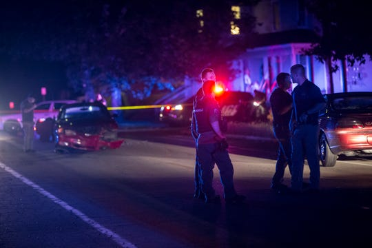Police investigate a shooting in the 1200 block of North Granville Avenue Wednesday night. Police were called to the scene around 8 p.m.