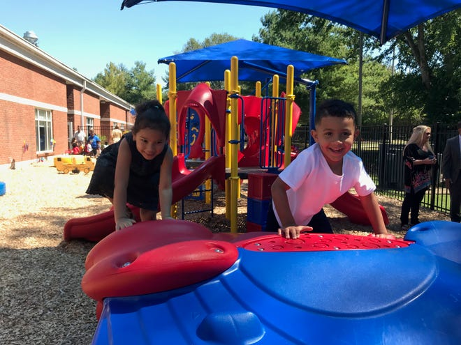Students Anthena Arisa and Bryson Haynes play on the new playground equipment at Community Child Care Center in Franklin. The equipment was funded through the work of Leadership Franklin Class of 2019 and community and business donations.