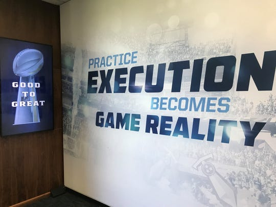 Coach Mike Vrabel's mantra -- Good to Great -- is shown on a screen at Saint Thomas Sports Park.