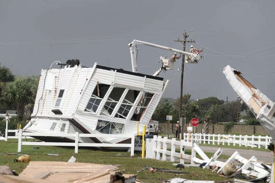 Power company lineman work to restore power after a tornado hit Emerald Isle N.C. as Hurricane Dorian moved up the East coast on Thursday, Sept. 5, 2019. (AP Photo/Tom Copeland)