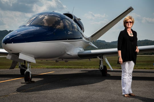 Amanda Farnsworth poses for a portrait with her airplane at John C. Tune Airport in Nashville on Sept. 4, 2019.