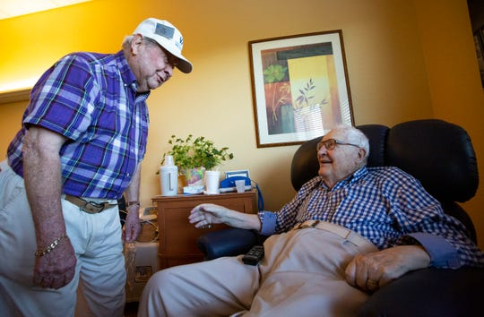 Tip Boerger talks to Dick Hamlin, 94, at Vi at Bentley Village on Thursday, September 5, 2019, in North Naples. There is a dozen of volunteer water boys, who are also the residents  at Bentley Village,  bring water to every residents at Bentley Care Center.