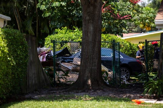 A vehicle accelerated through a Naples hotel parking lot, bushes and into the side of a house in the 700 block of Anderson Drive on Thursday, September 5, 2019, in North Naples.