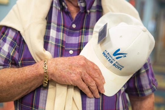 Tip Boerger holds hat over his chest at Vi at Bentley Village on Thursday, September 5, 2019, in North Naples. There is a dozen of volunteer water boys, who are also the residents at Bentley Village,  bring water to every residents at Bentley Care Center.