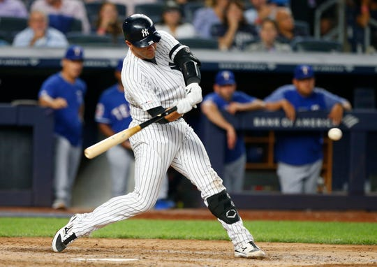 New York Yankees catcher Austin Romine hits a double against the Texas Rangers in the sixth inning at Yankee Stadium, Sept. 4, 2019.