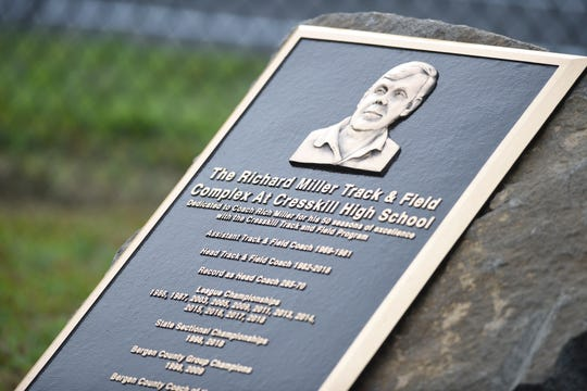 A plaque in honor of Rich Miller, a long-time Cresskill XC and track coach, during a ceremony naming the track at Cresskill High School in his honor on Thursday, September 5, 2019.
