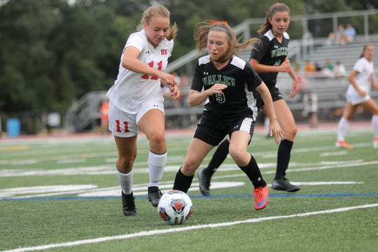 Carly Riembauer, of Northern Highlands and Mallory Downs, of Pascack Valley, go after the ball in the first half. Thursday, September 5, 2019