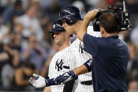 New York Yankees' Aaron Judge, center, greets teammates with Brett Gardner, left, who scored on Judge's third-inning, two-run home run in a baseball game against the Texas Rangers, Wednesday, Sept. 4, 2019, in New York. (AP Photo/Kathy Willens)