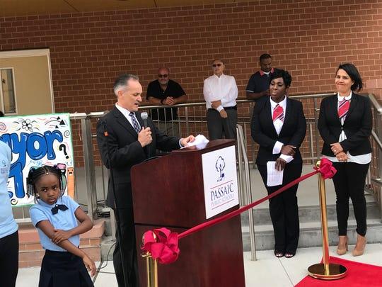 Interim CEO for NJ Schools Development Authority Manuel Da Silva makes remarks at opening of school 21 in Passaic.