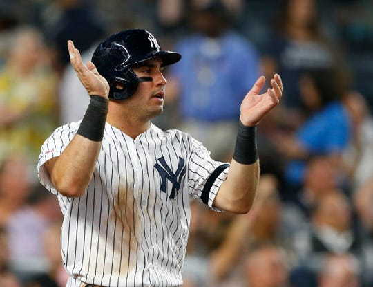 Sep 4, 2019; Bronx, NY, USA;  New York Yankees center fielder Mike Tauchman (39) acknowledges  catcher Austin Romine (28) (not pictured) after scoring on his double in the sixth inning against the Texas Rangers at Yankee Stadium. Mandatory Credit: Noah K. Murray-USA TODAY Sports