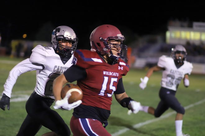 """Wildcat receiver Israel """"Cheeks"""" Reyes (15) took a short pass for a long gainer during Deming's 22-14 victory over Capital."""