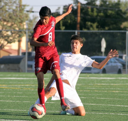 Junior Wildcat midfielder Jose Luis Perez (8) finds some daylight in the second half against Santa Teresa High on Tuesday.
