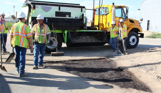 An Eddy County road crew prepares to fill in a pothole near Otis July 10. Eddy County Public Works Director Jason Burns said more projects are set for Derrick Road, Onsurez Road and Muscatel Avenue.