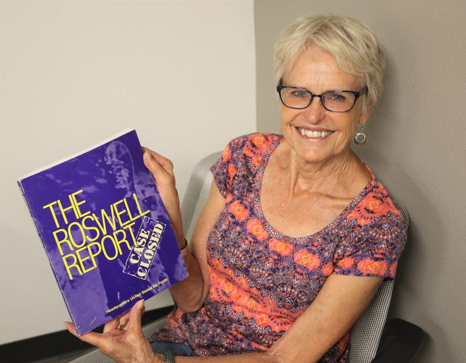 Author Connie Nordstrom displays a copy of a U.S. Air Force document she cites in her biography of her late husband Frank.