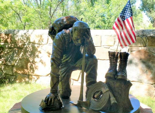 A memorial honoring firefighters is the gardens of the Smokey Bear Historical Park in Capitan, New Mexico.