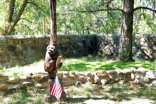 A carved tree of Smokey Bear stands at its burial site at the Smokey Bear Historical Park honoring the legacy and iconic symbol the bruin is.