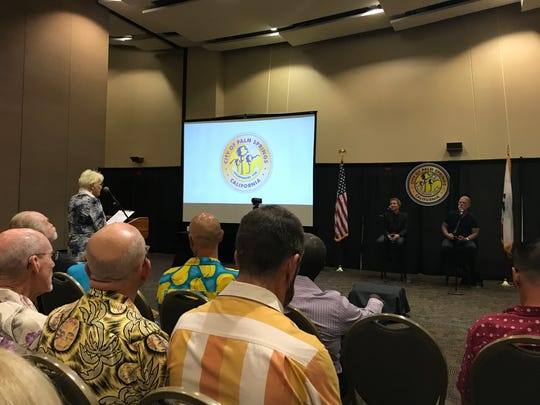 Mayor Pro Tem Geoff Kors and Councilmember J.R. Roberts listen to a resident at a community forum at the Palm Springs Convention Center on Wednesday, Sept. 4.
