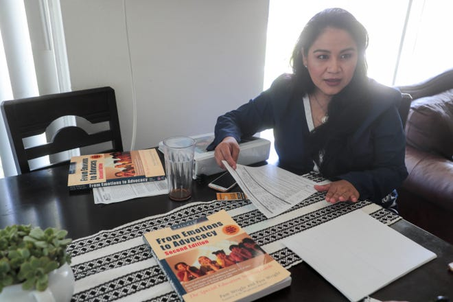 Lilia Ulloa reviews paperwork in her home in Riverside, Calif., on Tuesday, Sept. 3,  2019.