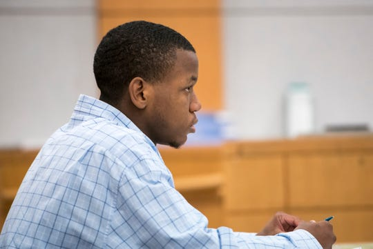 Antjuan Sanders listens during his trial at the Escambia County Courthouse in Pensacola on Thursday, September 5, 2019. Sanders is on trial for the murder of Susan Midyett.