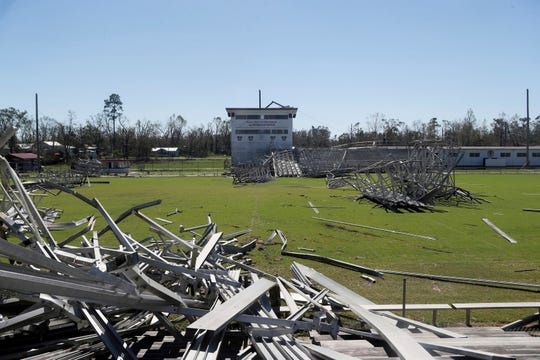 This undated photo shows damage to the bleachers and light poles at the Blountstown High School football field after Hurricane Michael went through areas in Blountstown, Fla. Today, there are new bleachers flanking the sidelines and new lights - hanging atop sturdier metal poles. The rural community of 2,500 people is one of Florida's poorest counties and where hurricane recovery has been especially slow. (Tori Schneider/Tallahassee Democrat via AP)