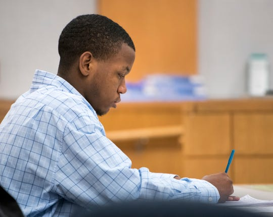 Antjuan Sanders listens during his trial at the Escambia County Courthouse in Pensacola on Thursday. Sanders is on trial for the murder of Susan Midyett.