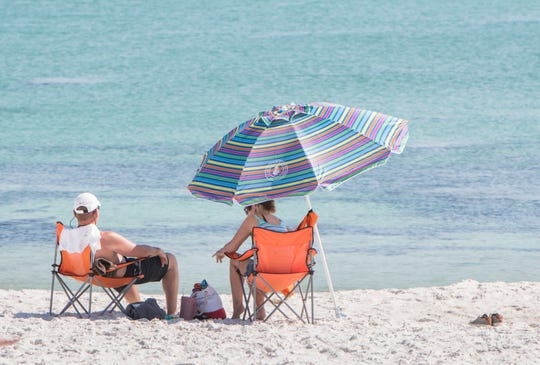 Navarre Beach visitors relax at the beach on Wednesday.