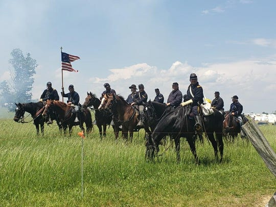 Union Calvary reenactors sit on their horses at the Battle of New Market reenactment in June 2019.