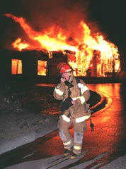 In December 2000, an arson fire rages on North 16th Street near the Phoenix Mountains Preserve as fire Capt. Brian Beck works the scene.