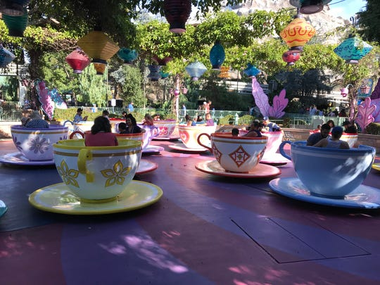 Taking a spin on the Mad Tea Party at Disneyland.