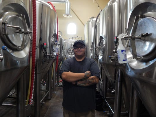 "Co-founder and ""head chef"" of 12 West Brewing Company, Noel Garcia."