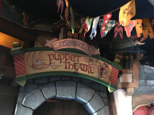 Riders enter the world of a string-free marionette in Pinocchio's Daring Journey  in Disneyland.