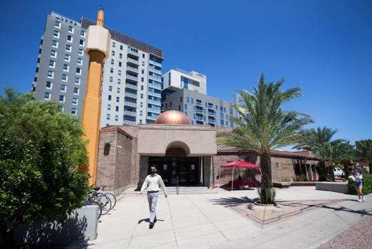 Residents of the Sol y Luna apartments threw glass bottles and alcohol at the Islamic Center of Tucson, say the buildings' owners.