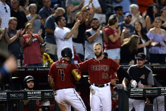 Arizona Diamondbacks second baseman Ketel Marte (4) celebrates with Arizona Diamondbacks first baseman Christian Walker (53) after hitting a grand slam against the San Diego Padres during the seventh inning at Chase Field on Wednesday, Sept. 4.
