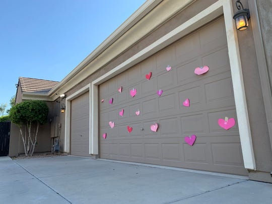 Pink paper hearts were placed on the front and garage doors of the home of a 3-year-old girl who died Sept. 3, 2019, after being left in a hot car in Gilbert.