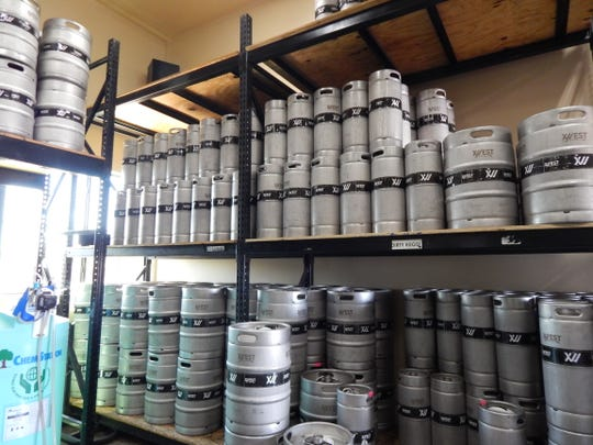 Kegs fill the middle room of the three part production facility at 12 West Brewing Company.