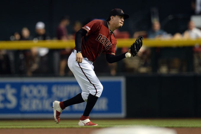 Sep 4, 2019; Phoenix, AZ, USA; Arizona Diamondbacks second baseman Wilmer Flores (41) drops a pop up during the fourth inning against the San Diego Padres at Chase Field. Mandatory Credit: Joe Camporeale-USA TODAY Sports