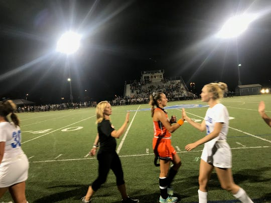 Palmyra and Lower Dauphin players and coaches slap hands in a display of sportsmanship following the latest matchup in their epic rivalry on Wednesday night. Lower Dauphin prevailed by a 2-1 score after Palmyra scored first a little over a minute into the game.