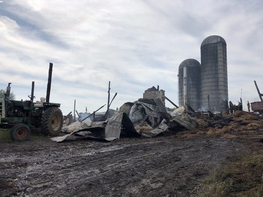 The debris was still smoking Thursday morning after a fire destroyed a barn Wednesday night in Myerstown.