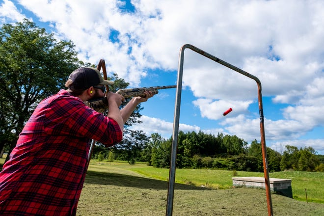 Nick McIntosh fires his rifle at a clay target Wednesday, Sept. 4, 2019, while clay shooting at Perch Point Conservation Club in Casco. The club holds regular shooting and archery nights throughout the year.