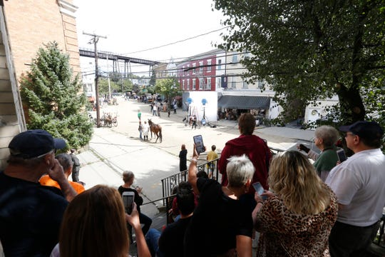 """Local residents watch crews working on  Mount Carmel Place in the City of Poughkeepsie for HBO's """"I Know This Much is True"""" on September 5, 2019."""