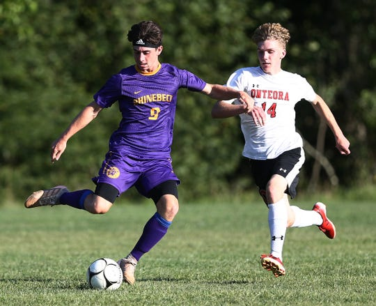 Rhinebeck's Noah Lortie looks to move the ball against Onteora defender Dan Rose during a Sept. 4 game.